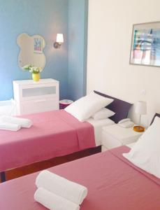 A bed or beds in a room at Agata