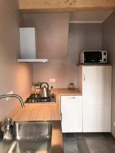 A kitchen or kitchenette at Bardonecchia Holidays