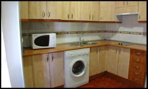 Una cocina o zona de cocina en Apartamentos Arquillo