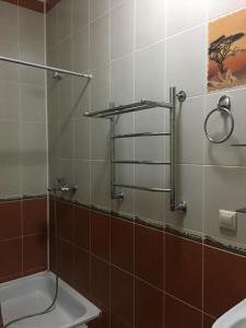 Ванная комната в Apartment on Tsiuriupy 70a