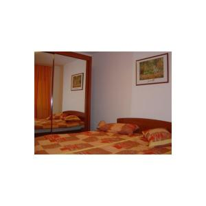 A bed or beds in a room at 3 rooms Piata Alba Iulia