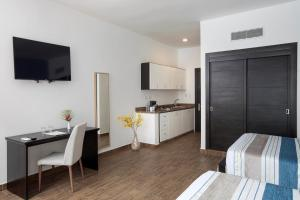 A kitchen or kitchenette at whala!urban punta cana