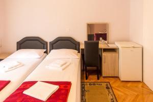 Guesthouse Blue Coast tesisinde bir odada yatak veya yataklar