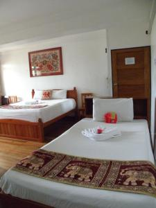 A bed or beds in a room at Tagimoucia House Hotel