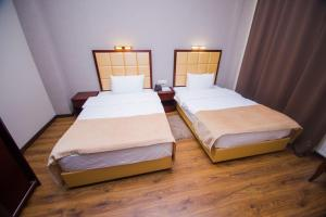 A bed or beds in a room at Hotel Orion Old Town
