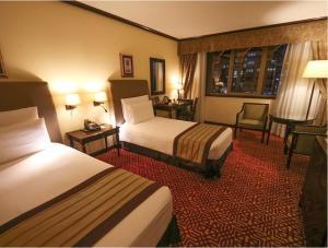 A bed or beds in a room at Dar es Salaam Serena Hotel