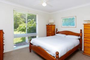 A bed or beds in a room at Stunning Home in Salamander Bay!
