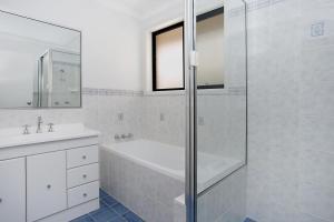 A bathroom at 'Seachange' stunning home & sleeps 10!
