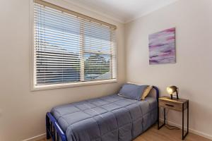 A bed or beds in a room at Spacious, Modern & Walk to the Beach!