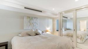 A bed or beds in a room at Aura apartment with Spectacular Views!