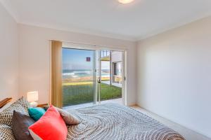 A bed or beds in a room at Hear the waves at Anna Bay!