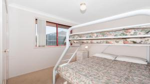 A bunk bed or bunk beds in a room at Peaceful, Quiet and so close to the beach!