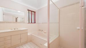 A bathroom at Peaceful, Quiet and so close to the beach!