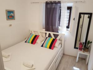A bed or beds in a room at White Rabbit Hostel