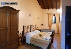 Letto o letti in una camera di Agriturismo Borgo San Nicolao