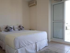 A bed or beds in a room at Apto c/ ar Split - Centro local imbatível - com NF