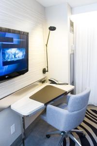A television and/or entertainment center at Novotel Toronto North York