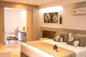 Cama ou camas em um quarto em Hotel Pousada do Bosque