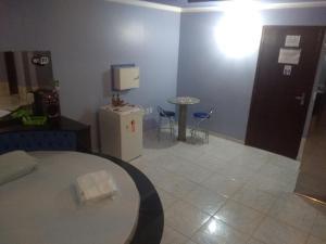 A kitchen or kitchenette at Motel Sedução (Adults Only)