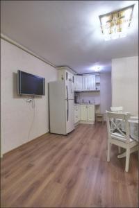 Телевизор и/или развлекательный центр в Апартаменты Большая Морская 31
