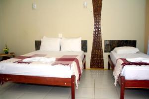 Cama ou camas em um quarto em Chalemar Hotel Pousada