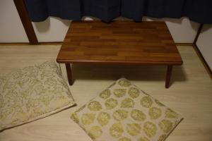 A bed or beds in a room at Guest house SHIE SHIMI