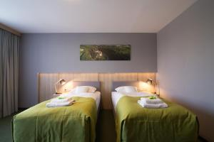 A bed or beds in a room at Centrum Hotelowo-Konferencyjne Witek