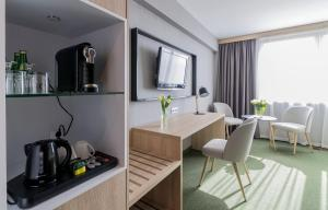 A kitchen or kitchenette at Centrum Hotelowo-Konferencyjne Witek