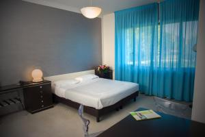A bed or beds in a room at Residence Hotel Torino Uno