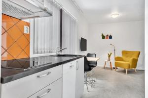 A kitchen or kitchenette at North of Lyngen Apartments AS