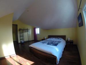 Un ou plusieurs lits dans un hébergement de l'établissement Villa des Bananiers