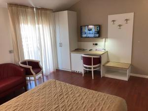 TV o dispositivi per l'intrattenimento presso Hotel Dal Ponte