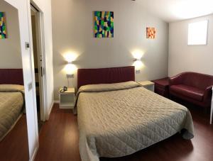 Letto o letti in una camera di Hotel Dal Ponte