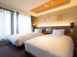A bed or beds in a room at Hotel Shiki Utsubo Park