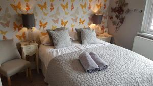 A bed or beds in a room at Butterfly Guest House