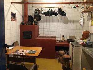 A kitchen or kitchenette at Pousada Canto dos Pássaros