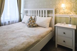 Кровать или кровати в номере Мини-отель Буше на Чистопрудном Бульваре