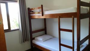 Uma ou mais camas em beliche em um quarto em Stammtisch Hostel