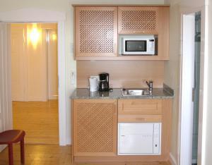 Кухня или мини-кухня в Villa Andante Apartmenthotel