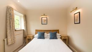 A bed or beds in a room at The Royal Oak Inn Luxborough