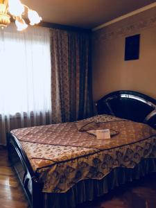 Кровать или кровати в номере Апартаменты на Ленина 1