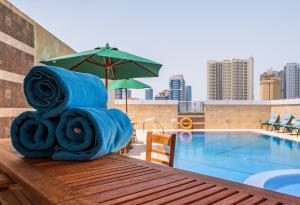 The swimming pool at or close to Tulip Inn Al Khan Hotel
