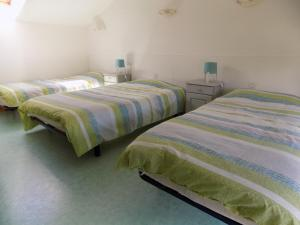 A bed or beds in a room at Gite 4 Logis Gascons