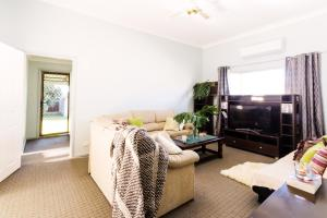 A television and/or entertainment center at Coal d' Vine Cottage - Cessnock NSW