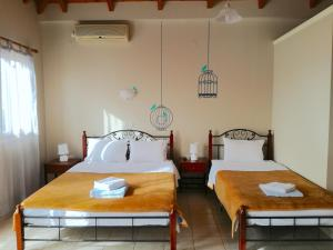 A bed or beds in a room at 12 Gods Resort