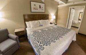 A bed or beds in a room at Days Inn by Wyndham Denver Downtown