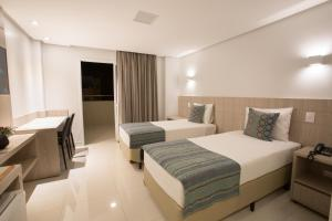 A bed or beds in a room at Solaris Hotel