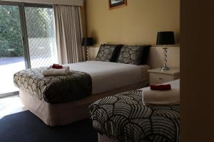 A bed or beds in a room at Kyabram Motor Inn