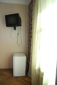 Телевизор и/или развлекательный центр в Мини-Отель Солнце