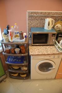 Кухня или мини-кухня в Мини-Отель Солнце